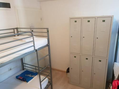 A bunk bed or bunk beds in a room at Hostel Split Garden