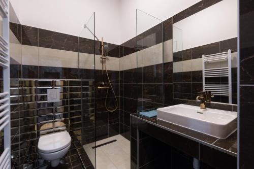 Koupelna v ubytování The H4 Executive Apartments