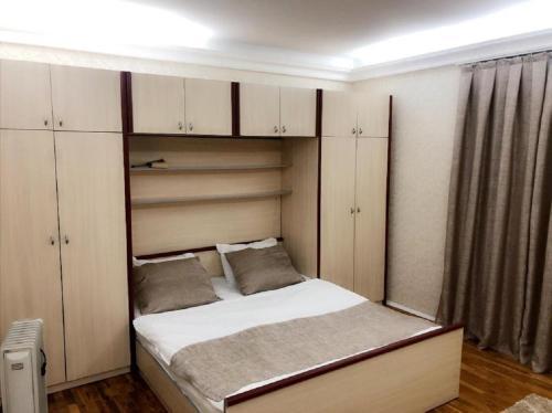 Cama ou camas em um quarto em Nizami street Apartments