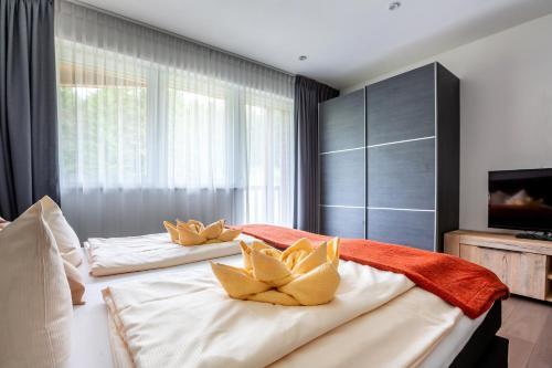 Postel nebo postele na pokoji v ubytování Aparthotel Alpenlodge