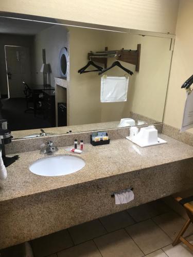 A bathroom at Super 8 by Wyndham Monroe