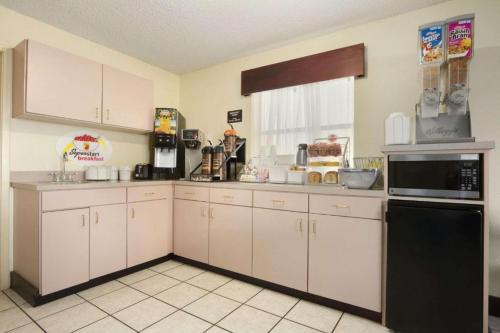 A kitchen or kitchenette at Super 8 by Wyndham Monroe