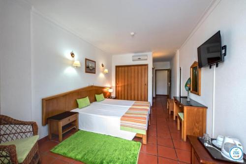 Cama o camas de una habitación en Colina do Mar