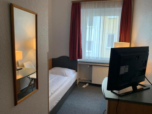 A bed or beds in a room at Hotel Berg