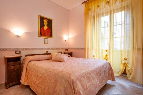 A bed or beds in a room at B&B Locanda Il Tufo Rosa