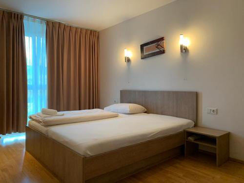 Кровать или кровати в номере Da Yang