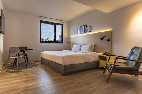 A bed or beds in a room at amba Taipei Ximending