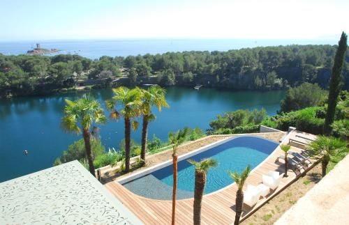 The swimming pool at or near Villa ALFONSA