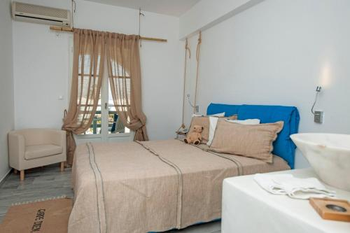 A bed or beds in a room at Margarita Studios Ambelas