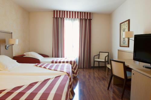 Cama o camas de una habitación en Duran Hotel & Restaurant