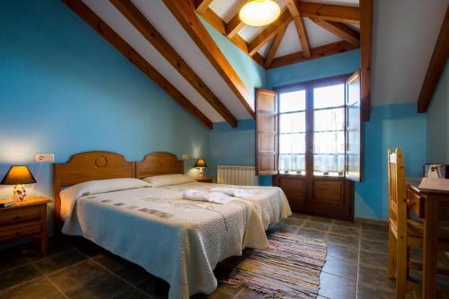 Cama o camas de una habitación en Apartamentos Rurales Los Pontigos