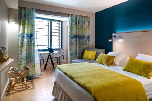 Un ou plusieurs lits dans un hébergement de l'établissement Best Western Montecristo-Bastia