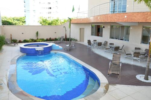 The swimming pool at or near Lotus Hotel