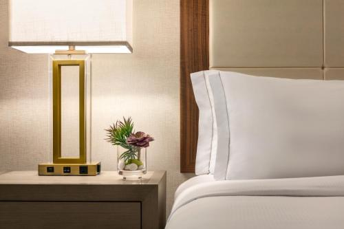 A bed or beds in a room at Hilton Suites Ocean City Oceanfront