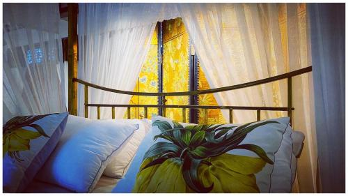 A bed or beds in a room at สิบสองหน่วยตัด