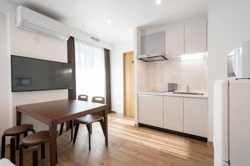 A kitchen or kitchenette at Eisei Stay