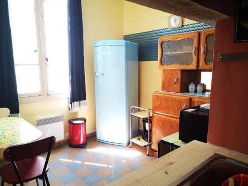 Cuisine ou kitchenette dans l'établissement Picoti Picota