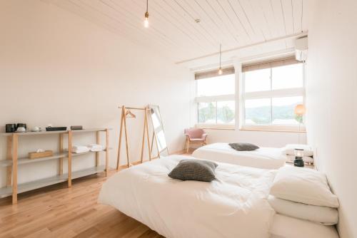 Un ou plusieurs lits dans un hébergement de l'établissement ノルディスクビレッジ 五島アイランズ