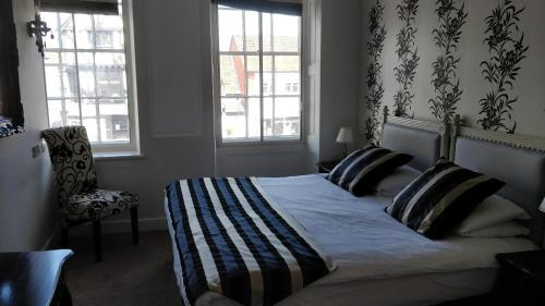A bed or beds in a room at The Spread Eagle Hotel