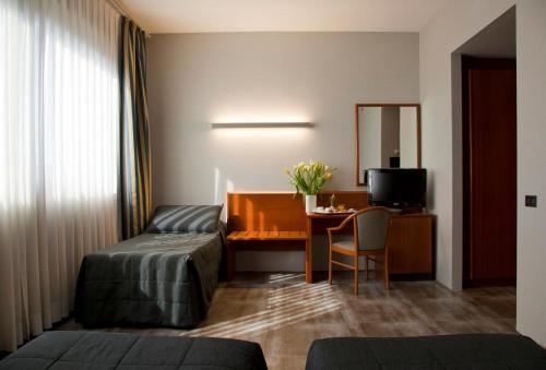 Ein Sitzbereich in der Unterkunft Hotel Zone