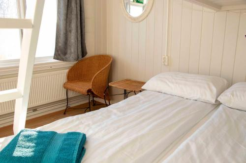 A bed or beds in a room at Puffin Hostel Vík
