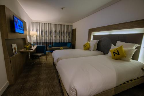 A bed or beds in a room at Novotel Mohammedia