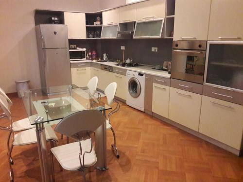 A cozinha ou cozinha compacta de Metro Old Town.Apartment