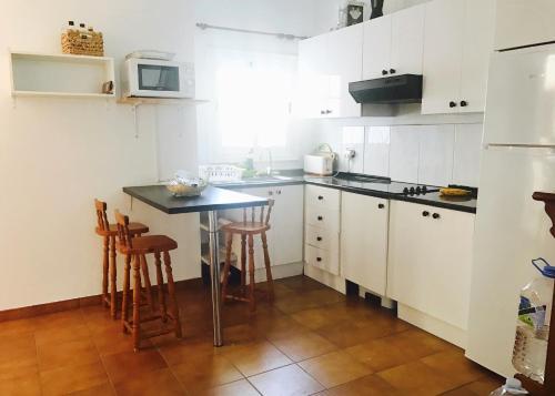 Küche/Küchenzeile in der Unterkunft WIFI TENERIFE SUR GUEST HOUSE