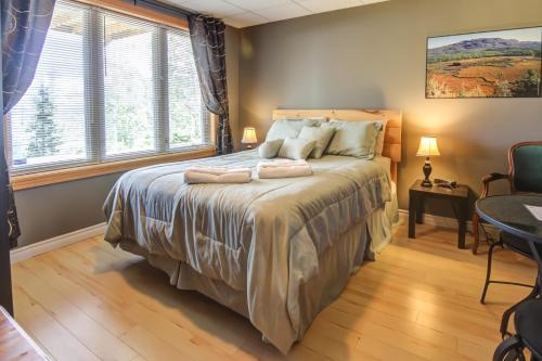 Un ou plusieurs lits dans un hébergement de l'établissement Gîte du Chalet les Berges