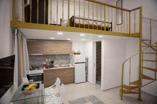 A kitchen or kitchenette at Aimou Studios & Apartments Piraeus