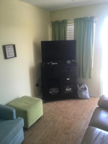 A television and/or entertainment center at Surf Song Beach Resort