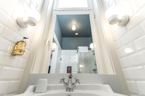 Um banheiro em Home Lisbon Hostel