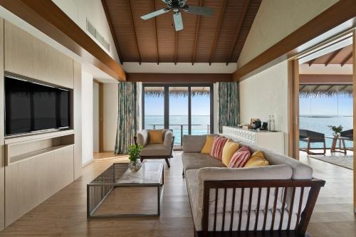A seating area at Pullman Maldives All-Inclusive Resort