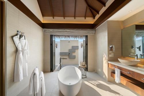 A bathroom at Pullman Maldives All-Inclusive Resort