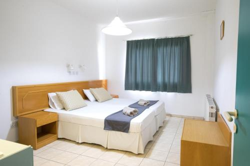 A bed or beds in a room at DebbieXenia Hotel Apartments