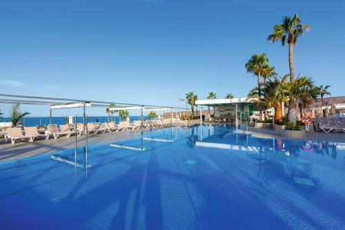 The swimming pool at or near Riu Vistamar - All Inclusive