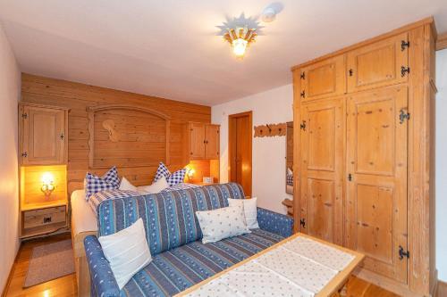 Ein Bett oder Betten in einem Zimmer der Unterkunft Beim Gschdoaga