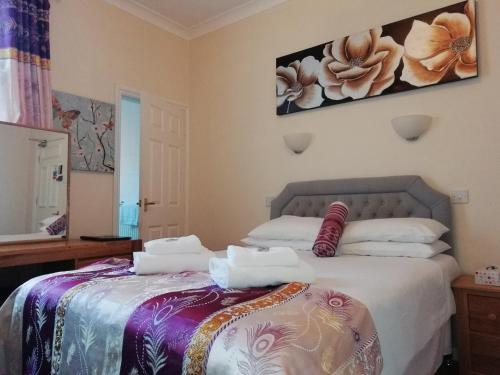A bed or beds in a room at Diamonds Guest House