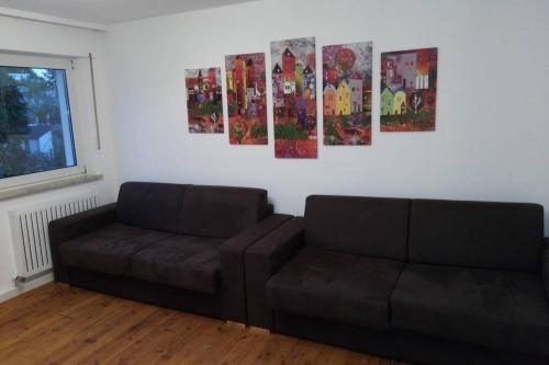A seating area at Up to 8! New, modern, near city, Messe and airport