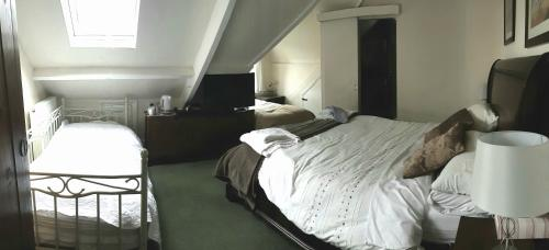 A bed or beds in a room at The Adelphi Bed & Breakfast