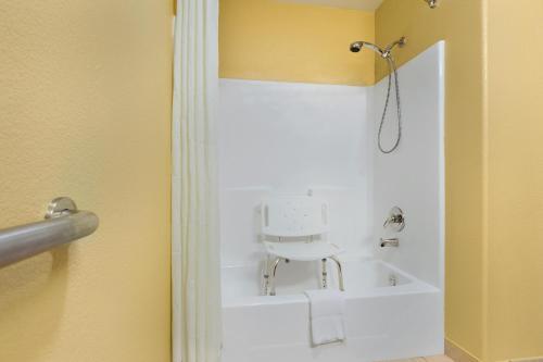 A bathroom at Days Inn by Wyndham Lumberton