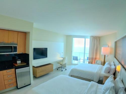 A television and/or entertainment center at Hilton Fort Lauderdale Beach Resort