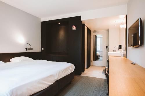 Cama o camas de una habitación en Buitenplaats Vaeshartelt