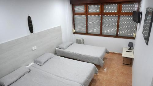A bed or beds in a room at Hotel Pinar Somo Surf
