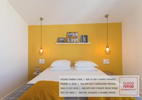 A bed or beds in a room at Aveiro Rossio Bed & Breakfast
