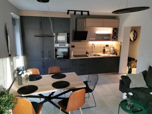 A kitchen or kitchenette at Romana Dream apartment