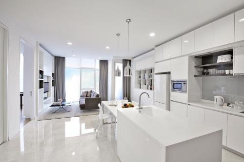 A kitchen or kitchenette at THE FACE Suites