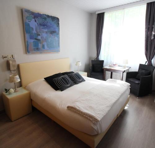 Un ou plusieurs lits dans un hébergement de l'établissement Hotel Georges