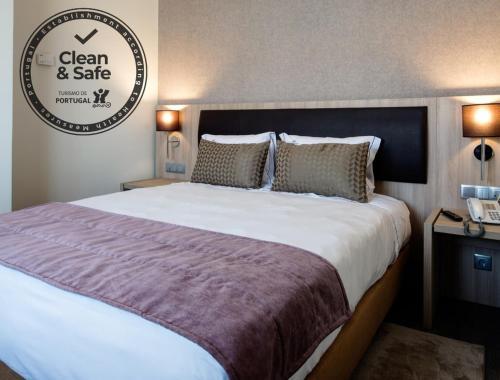 Cama o camas de una habitación en VIP Inn Berna Hotel