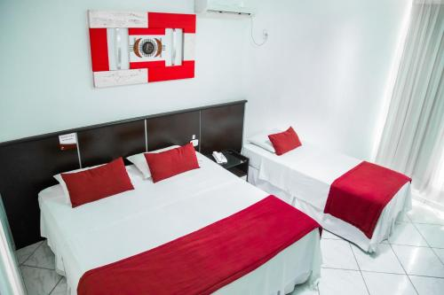 A bed or beds in a room at Brasilia Park Hotel